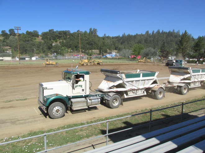 Soil being leveled and compacted at the high school football field.
