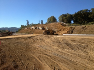 Moving soil from the west side of Route 101 near the future south interchange.