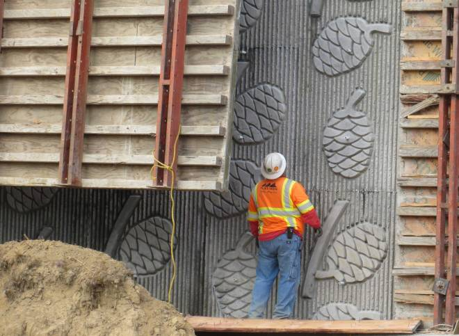 The redwood cone pattern emerges as the form is stripped away from a retaining wall near the new south interchange.  This wall may be visible from the new northbound Route 101 onramp.